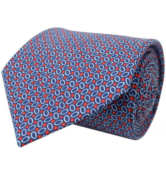 Corbata con estampado geométrico en color azul, blanco y rojo de seda